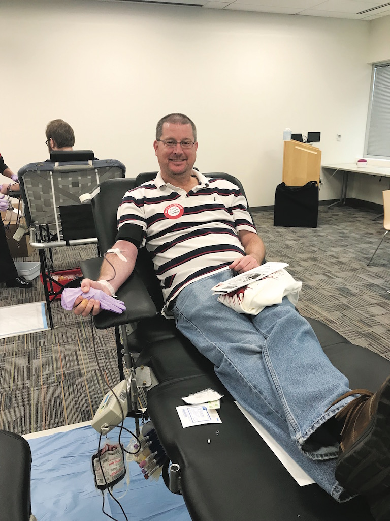 USAA employee giving blood